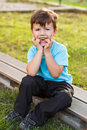 Little kid teeth smile boy sit and outdoor Stock Images