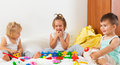 Little kids playing on  white bed Royalty Free Stock Photo