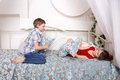 Little kidsl fighting pillows and playing Royalty Free Stock Photo