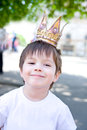 Little king smiling boy in crown in summer Stock Photography