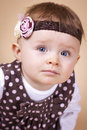Little lady with a headband portrait studio photo Stock Photography