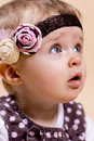 Little lady with a headband portrait studio photo Royalty Free Stock Image