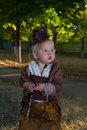 Little lady with an umbrella in the park in old clothes Royalty Free Stock Photos
