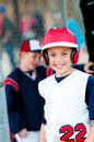Little league baseball boy in dugout Royalty Free Stock Photo