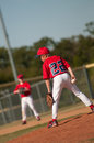 Little league baseball player looking home Stock Photo