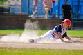 Little league baseball player sliding home. Royalty Free Stock Photo