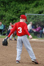 Little league player waiting for action a baseman the next play Royalty Free Stock Photos