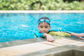 Little mix Asian Arab boy swimming at swimming pool outdoor activity Royalty Free Stock Photo