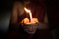 Little monk blessing holding a candlelight Royalty Free Stock Photography