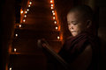 Little monk reading book inside monastery Royalty Free Stock Images