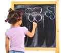 Little mulatto girl draws on the board Stock Image