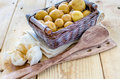 Little new potatoes in a small basket Stock Photo