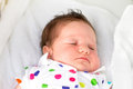 Little newborn baby taking a nap in her stroller on sunny summer day Stock Images