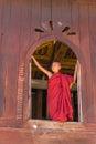 Little novice shwe yan pyay monastery nyaung shwe in myanm at ancient window myanmar burmar Stock Photos