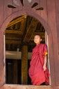 Little novice shwe yan pyay monastery nyaung shwe in myanm smiling at ancient window myanmar burmar Royalty Free Stock Image