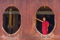 Little novice shwe yan pyay monastery nyaung shwe in myanm at window myanmar burmar Royalty Free Stock Image