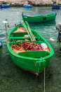 Little old fishing boats typical colorful in the south of italy apulia region Stock Image