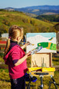 Little painter at work near waterfall Royalty Free Stock Photo