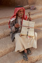 Little Petra, Jordan – June 20, 2017: Old Bedouin man or Arab man in traditional outfit, playing his musical instrument .
