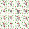 Little pig in Santa Claus hat with green Christmas trees