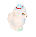 Little pink rubber toy sheep in hat isolated on white background Stock Photo