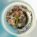 Little planet 360 degree sphere. Panoramic view of Malaga bullring La Malagueta and seaport Royalty Free Stock Photo