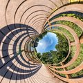 Little planet transformation of spherical panorama 360 degrees. Spherical abstract aerial view on wooden bridge. Curvature of Royalty Free Stock Photo