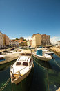 Little port of an italian village the muggia near trieste in italy in a sunny summer day Stock Photos