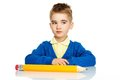 Little preschool boy in blue cardigan and yellow shirt with big pencil Stock Image