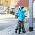 Little preschool kid boy riding with his first green bike Royalty Free Stock Photo