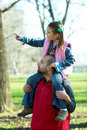 Little pretty child on father shoulder Stock Photo