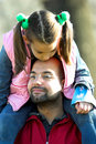 Little pretty child on father shoulder Stock Image