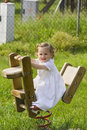 A little pretty child swinging Royalty Free Stock Photos