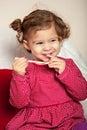Little pretty cute girl eats Christmas sweets Royalty Free Stock Photo