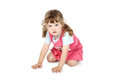 Little pretty girl crawls on floor isolated white background Royalty Free Stock Images