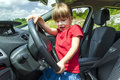 Little pretty girl having hard time driving a car Royalty Free Stock Photo
