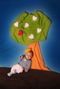 Little prince sitting under a love tree Stock Image
