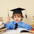 Little professor in academic hat with rarity pen among old books the Royalty Free Stock Photo