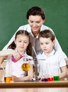 Little pupils pour chemical liquids Stock Images