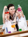 Little pupils study chemistry Stock Photos