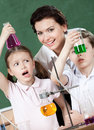Little pupils wonder at the result of experiment Stock Photography