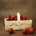 Little red apples in a basket Royalty Free Stock Images