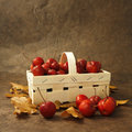 Little red apples in a basket Stock Photo