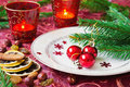 Little red christmas balls in a plate on the holiday table and new year s idea Royalty Free Stock Images