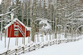 Little red house covered by snow Stock Images