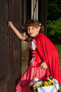 Little red riding hood knocking on door Royalty Free Stock Photo