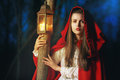 Little Red riding hood lighted by a lantern Royalty Free Stock Photo