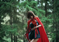 Little red riding hood in the wild forest beautiful dark haired girl a cloak was lost story fairy tale and legend grain Stock Photos