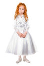 Little redhead girl posing in nice white dress isolated Royalty Free Stock Photography