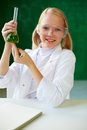 Little researcher portrait of cute schoolgirl holding tube with chemical liquid and looking at camera Royalty Free Stock Photography